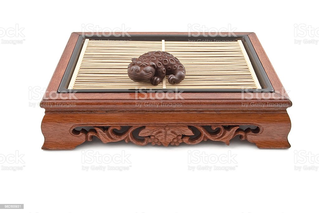 chinese chimera figurine on wooden table royalty-free stock photo