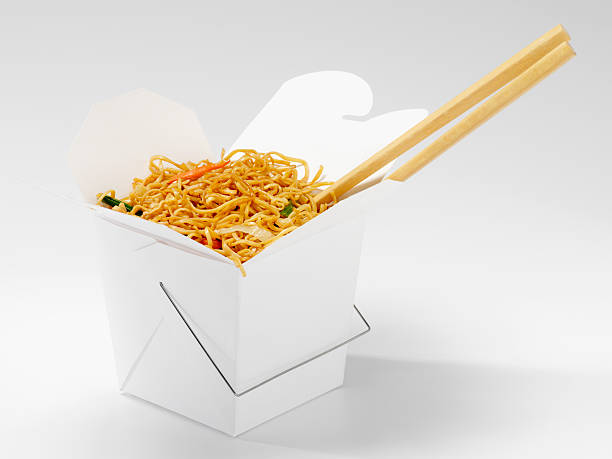 Chinese Chow Mein with Chopsticks Chinese Chow Mein with Chopsticks in Take Out Container -Photographed on Hasselblad H1-22mb Camera chinese takeout stock pictures, royalty-free photos & images