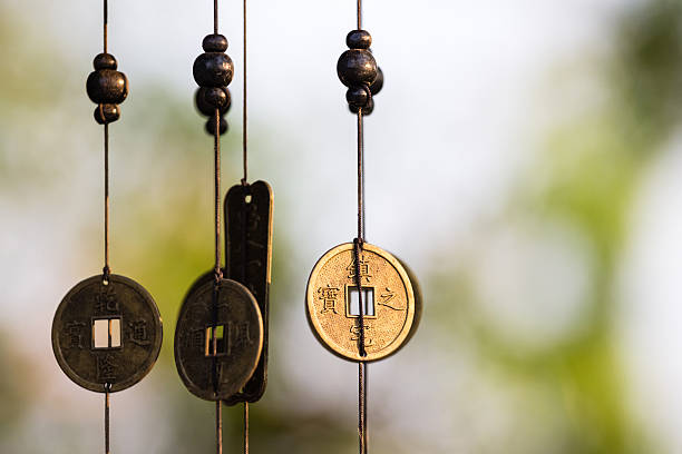 Chinese coins chime Antique Chinese coins hanged outside the house as wind chimes  for protection and good luck taoism stock pictures, royalty-free photos & images