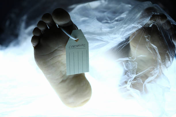 Chinese corona virus fear concept Male leg with tag lies on table in morgue. Chinese corona virus fear concept dead stock pictures, royalty-free photos & images