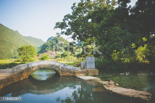 A ancient stone bridge in Chinese countryside