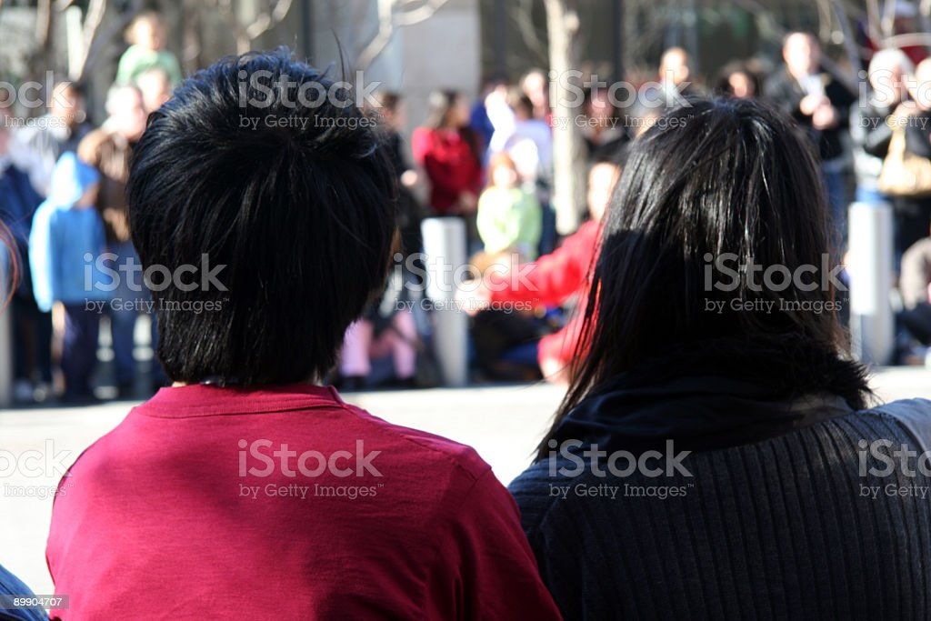 Chinese Couple watching street show royalty-free stock photo