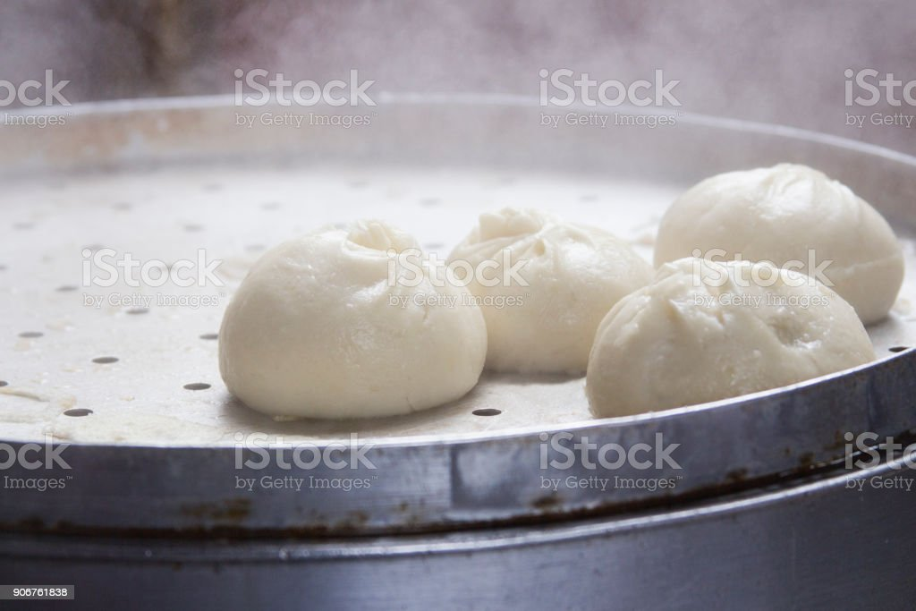 chinese cuisine buns steamed in a steamer steaming stock photo