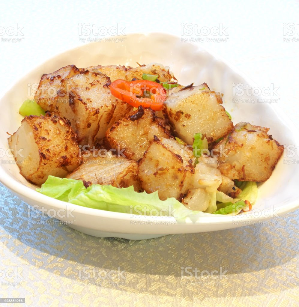 Chinese cuisine - Pan-fried radish cake with spicy XO sauce stock photo