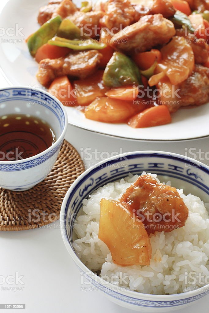 chinese cuisine, sweet and sour pork chop on rice royalty-free stock photo