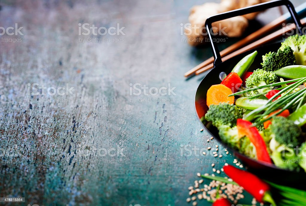 Chinese cuisine. Wok cooking vegetables. stock photo