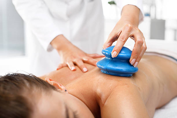 chinese cupping massage. back massage bubble chinese. - cupping therapy stock photos and pictures