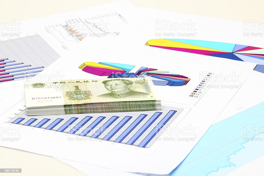 Chinese Currencies and graphs royalty-free stock photo