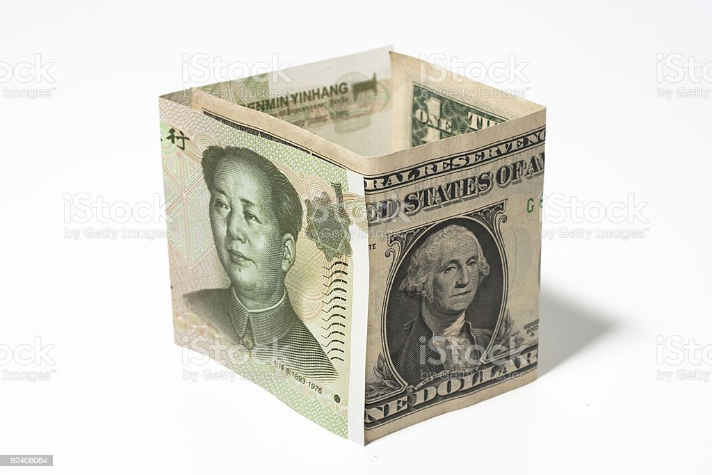Chinese currency and American dollar royalty-free stock photo