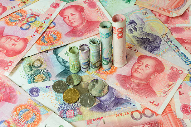 Chinese currency forming a graph, Chinese currency forming a graph, Appreciation of the Chinese yuan chinese currency stock pictures, royalty-free photos & images