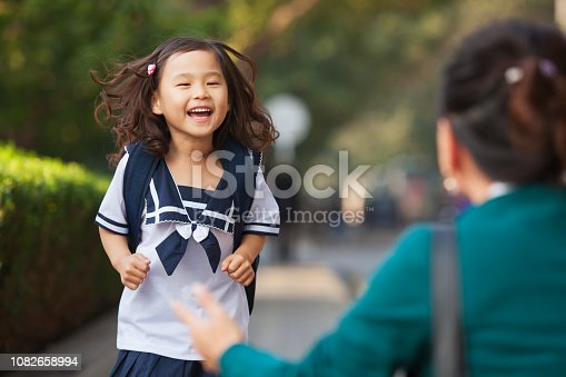 Chinese daughter running to greet her mother