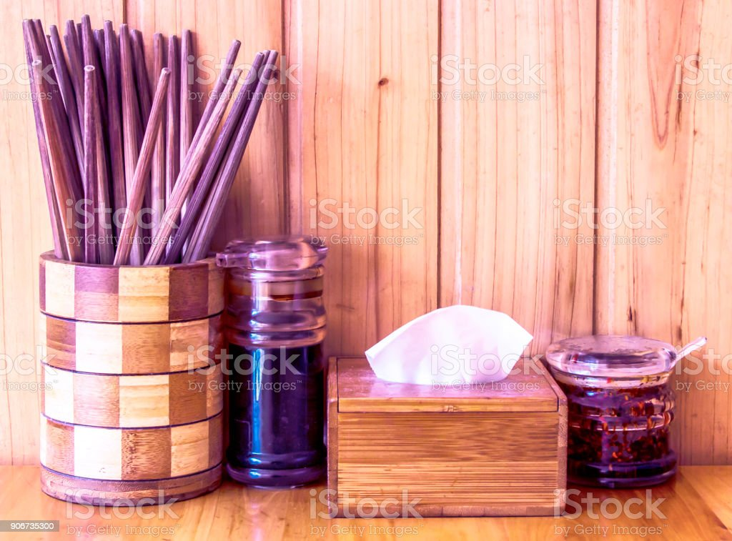 Chinese diet, chopsticks and condiments on the noodle table stock photo