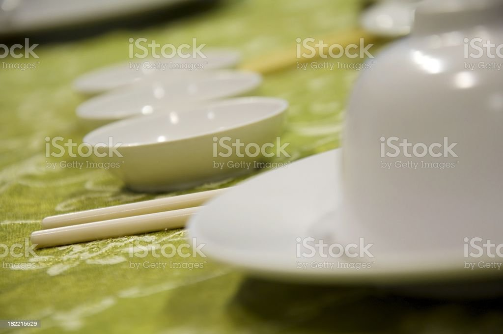 Chinese dining table setting having plates and chopsticks royalty-free stock photo