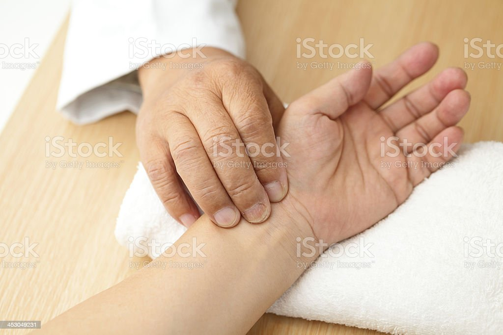 Chinese doctor diagnose pulse of patient royalty-free stock photo