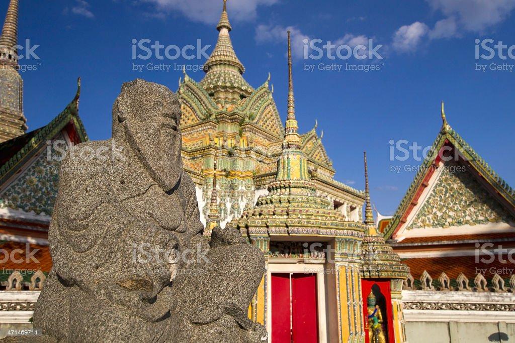 Chinese doll stones on Wat Pho background stock photo