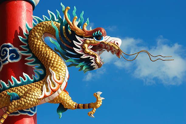 Chinese dragon in front of blue sky stock photo