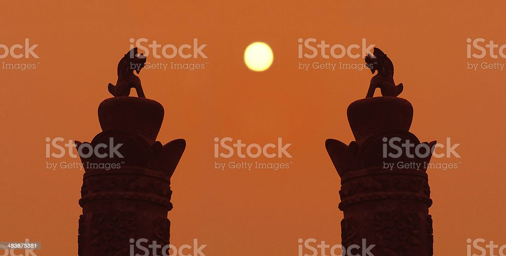 Chinese dragons pole during sunset stock photo