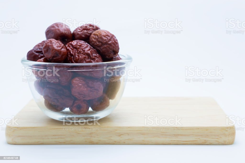Chinese dried red jujube on wooden board stock photo