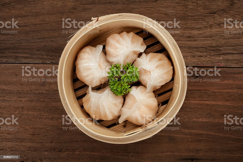 Chinese dumpling in a bamboo steamer box stock photo
