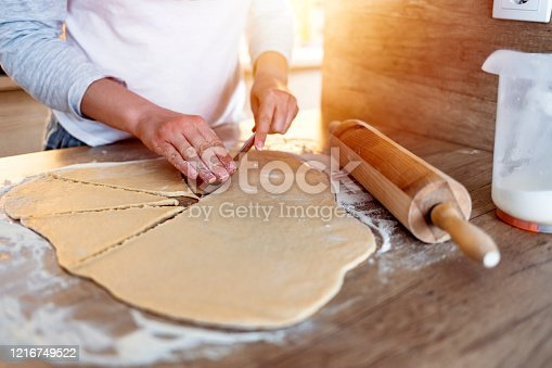 673400318 istock photo Chinese dumplings making process, cutting dough onto slices 1216749522