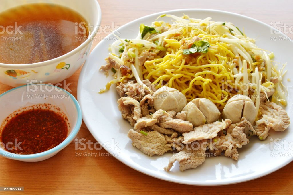 Chinese egg noodle topping boiled pork and soup with sauce royalty-free stock photo