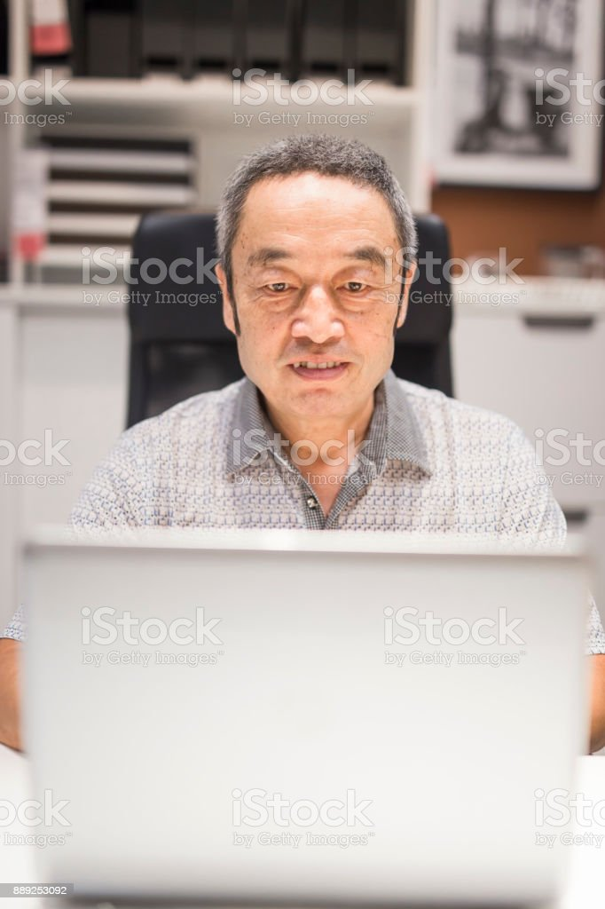 Chinese elderly in office stock photo