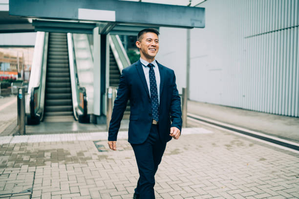 chinese entrepreneur going to work - styles stock photos and pictures