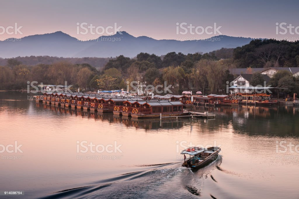 Chinese evening landscape with fishing boat stock photo