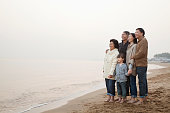 Chinese family standing on beach