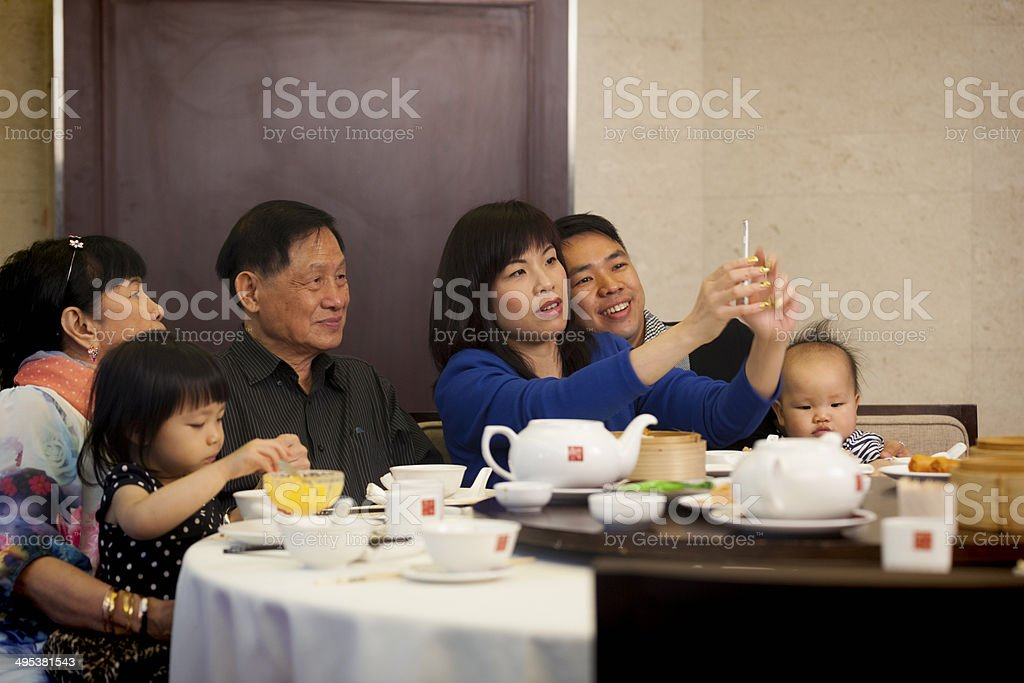Chinese family taking selfie stock photo