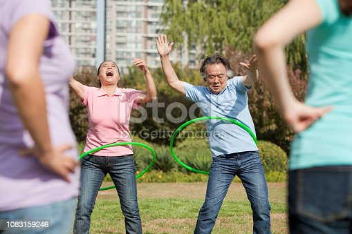 istock Chinese family with plastic hoop in park 1083159246