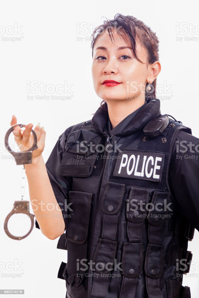 Chinese female police officer holding handcuffs stock photo