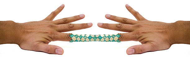 chinese finger trap 2 - trapped stock pictures, royalty-free photos & images