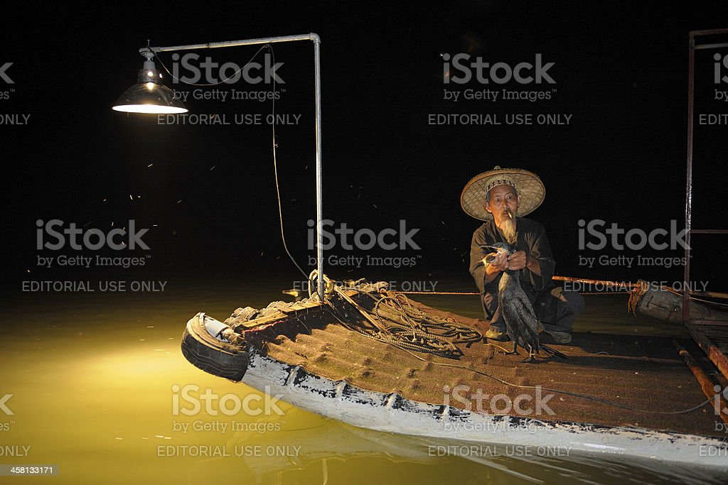 Chinese fisherman with cormorant at Li river stock photo