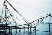 Hampi, Kerala, India -January 21, 2016: Indian people fishing with chinese fishing net