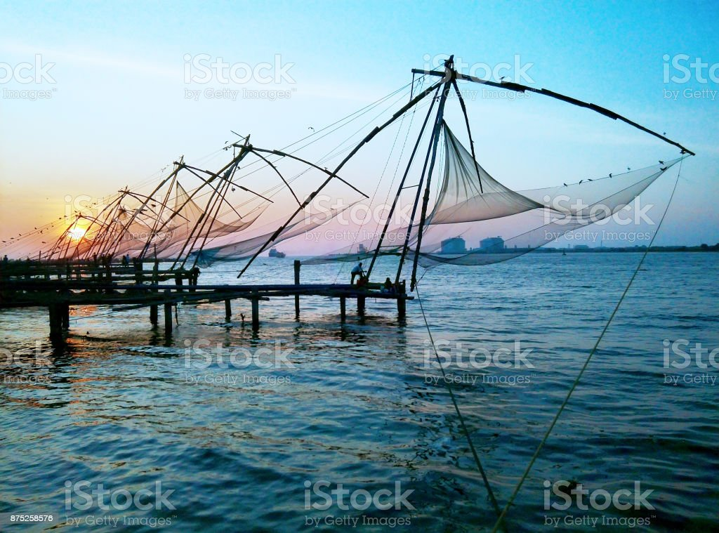 Chinese Fishing Nets at sunset, Fort Kochin, India. stock photo