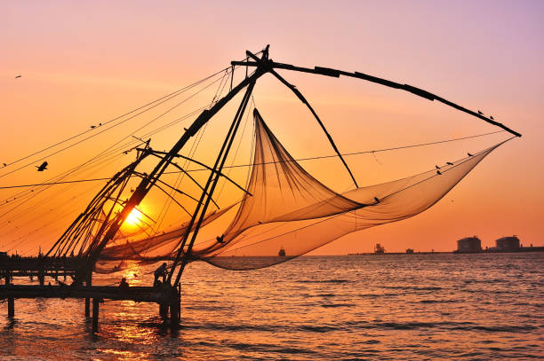Chinese Fishing Nets at sunset, Fort Kochin, India. stock photo