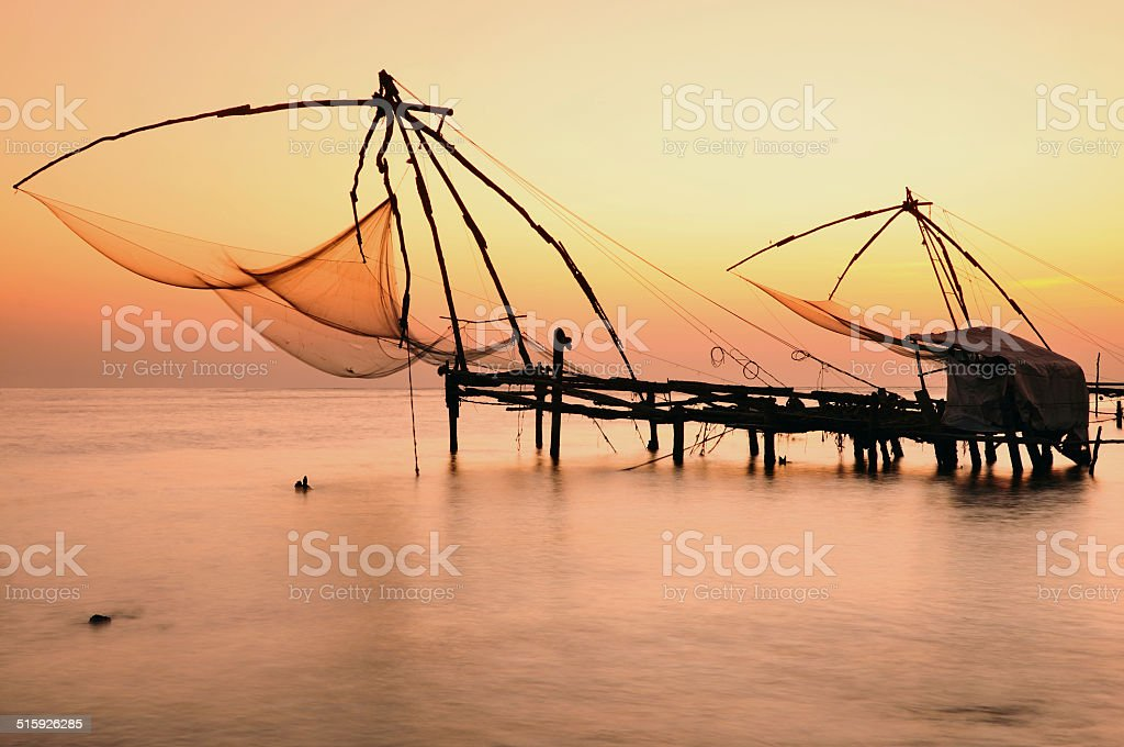 Chinese Fishing Nets at Sunset, Vypeen Island, Cochin, Kerala, India stock photo