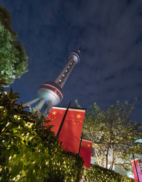 Chinese flag and Pearl Tower in Shanghai stock photo