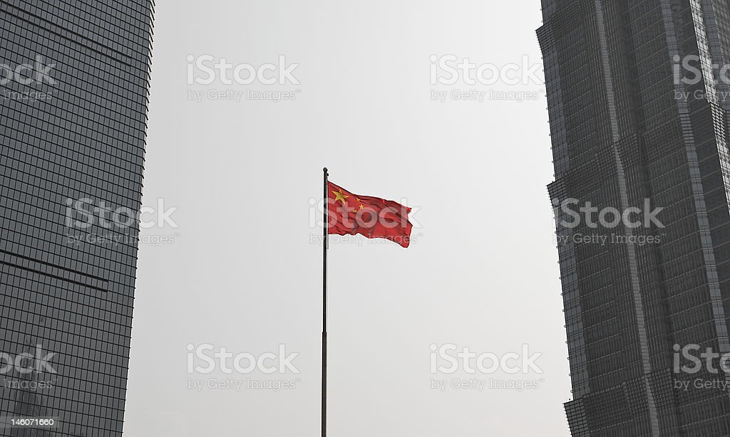 Chinese flag between two skyscrapers stock photo