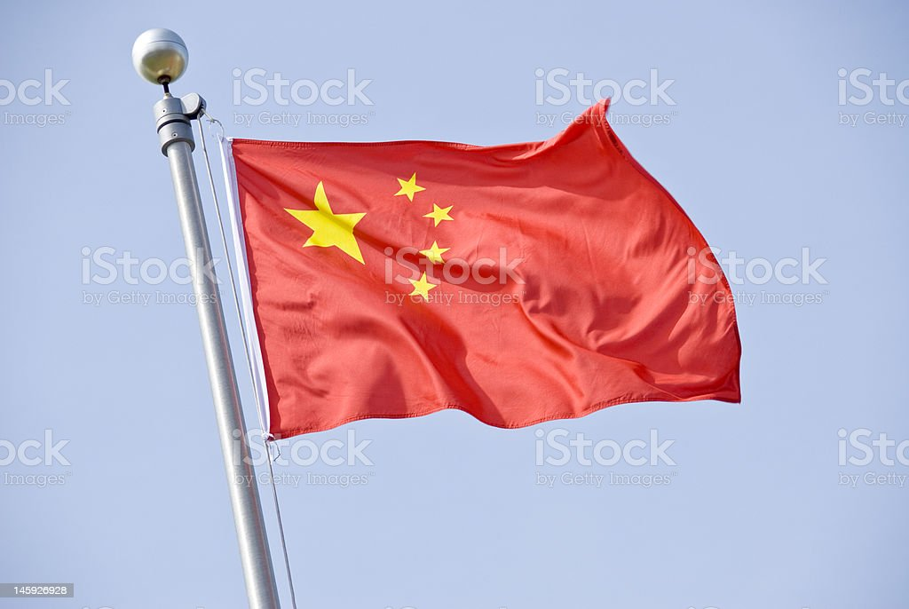 Chinese Flag Five star red Chinese flag flying against the blue sky. Chinese Flag Stock Photo