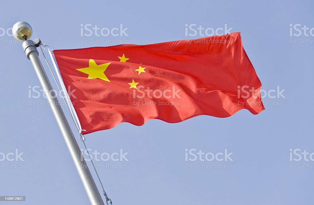 Chinese Flag Series Five star red Chinese flag flying against the blue sky. Asia Stock Photo