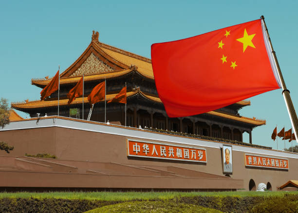 chinese flag with beijing imperial palace - 共産主義 ストックフォトと画像
