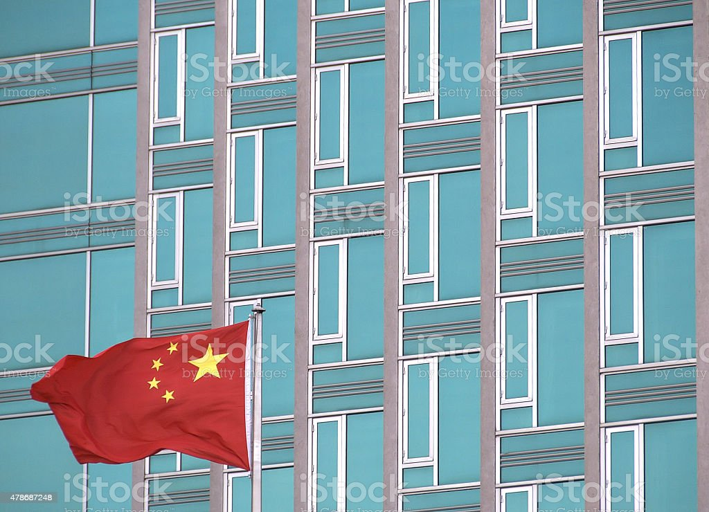 Chinese flag with modern office building stock photo