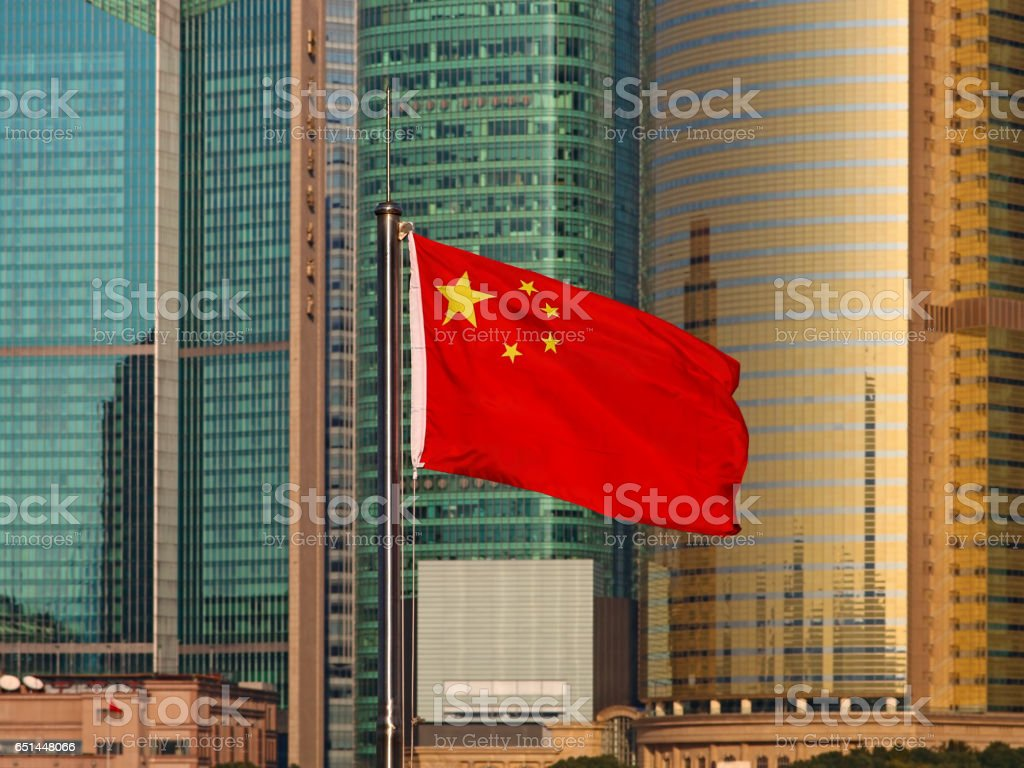 Chinese flag with skyscrapers stock photo