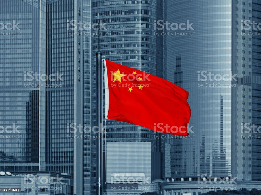 Chinese flag with skyscrapers royalty-free stock photo