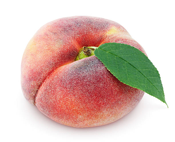 Chinese flat donut peach with leaf on white stock photo