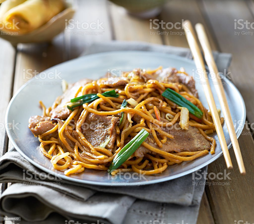 chinese food - beef lo mein on a plate stock photo