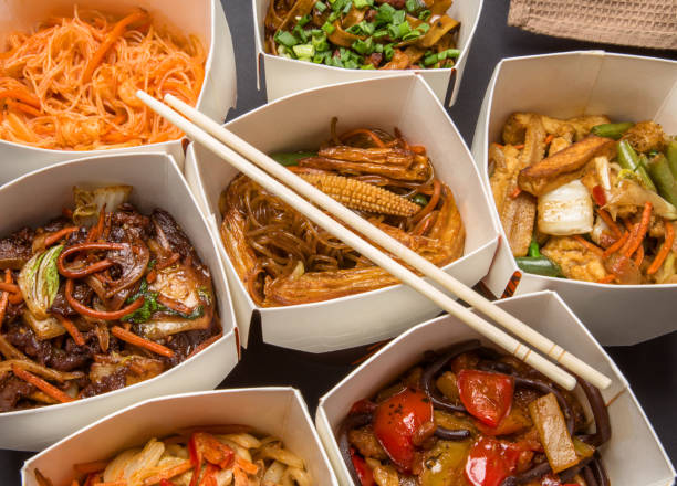 Chinese food in different cardboard boxes stock photo