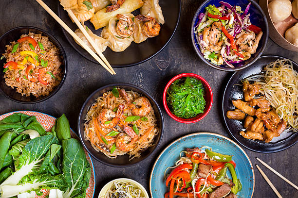 chinese food on a dark table - chinese food stock photos and pictures